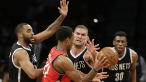 Brooklyn Nets center Brook Lopez putting defensive moves on Toronto Raptors' DeMar DeRozan