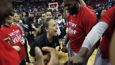 Becky Hammon (center), first woman to coach an NBA Summer League team, also became the first woman to win an NBA Summer League championship.