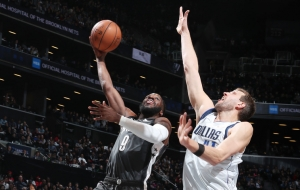 Brooklyn Nets forward DeMarre Carroll going up to score a basket with Dallas Mavericks forward Dirk Nowitzki defending on March 4, 2019, at the Barclays Center in Brooklyn, NY