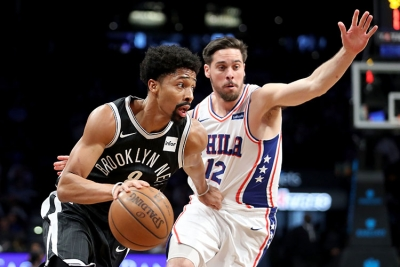 Spencer Dinwiddie, Nets point guard, driving past Sixers TJ McConnell on January 1, 2018, at the Barclays Center