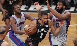 Brooklyn Nets guard Spencer Dinwiddie surrounded by Detroit Pistons players, Reggie Jackie (left) and Andre Drummond (right) at a basketball game at the Barclays Center on March 11, 2019. The Brooklyn Nets defeated the Detroit Pistons 103-75.