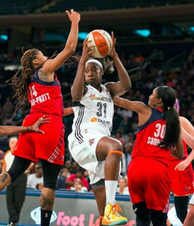 New York Liberty center Tina Charles surrounded by Washington Mystics players goes up for two points