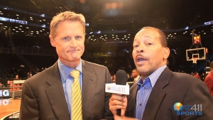Golden State Warriors head coach Steve Kerr talking with What's The 411Sports correspondent Andrew Rosario prior to the first game between the Brooklyn Nets and the New York Knicks at the Barclays Center in Brooklyn.