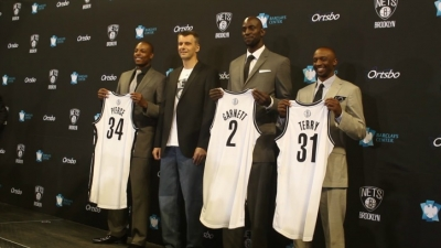 Photo from Left to Right: Paul Pierce, Mikhail Prokhorov, Brooklyn Nets Principal Owner; Kevin Garnett, and Jason Terry