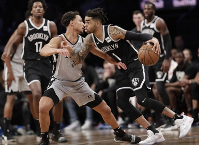 Brooklyn Nets guard D'Angelo Russell drives past San Antonio Spurs guard Bryn Forbes on the road to a Nets 101-85 victory over the Spurs